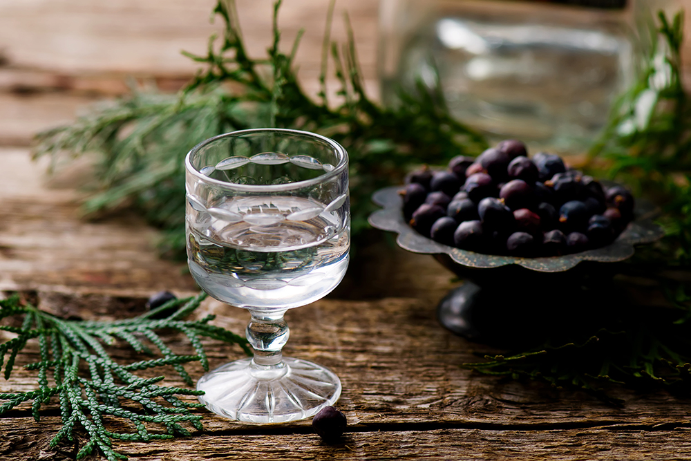 gin in a glass shot glass. selective focus
