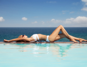 Young beautiful woman sunbathing. Nice sea view from swimming pool. | © yuriyzhuravov by fotolia.com